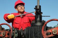 Les travaux avec de l'huile et l'industrie du gaz. Photographie stock libre de droits