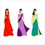Les trois belles femmes d'Inde avec la robe de couleur conçoivent Photographie stock libre de droits