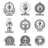 Les trophées et les récompenses de victoire dirigent des logos, insignes, emblèmes Photographie stock