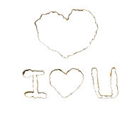 Les trous brûlés avec amour signent dedans une partie de papier Photo libre de droits