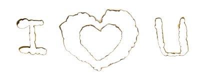 Les trous brûlés avec amour signent dedans une partie de papier Photo stock