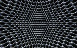 Les trous ronds tordus de macro grille grise métallique amassent la texture Photo libre de droits