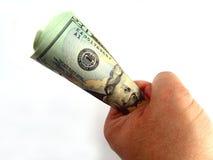 Les USA billets de vingt dollars et main Photos stock