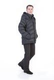 les vêtements équipent vers le bas des jeunes de l'hiver Image stock