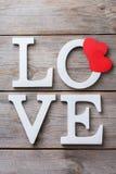 Les vacances de jour de valentines marquent avec des lettres le message textuel pour aimer le fond de carte Photo libre de droits