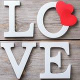 Les vacances de jour de valentines marquent avec des lettres le message textuel pour aimer le fond de carte Image libre de droits