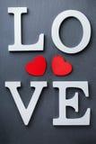 Les vacances de jour de valentines marquent avec des lettres le message textuel pour aimer le fond de carte Photo stock