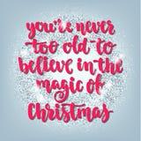 Les vacances de salutation de Noël et de bonne année remettent la carte de lettrage Photo stock