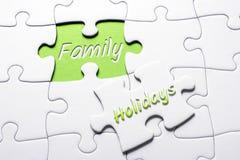 Les vacances et la famille de mots dans le casse-tête absent de morceau photos libres de droits