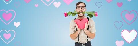 Les valentines équipent avec se sont levées tenant le coeur avec le fond de coeurs d'amour Photos libres de droits