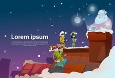Les verres de réalité virtuelle d'usage de groupe d'Elf voient année de vacances de Santa Claus Sack Roof Chimney Christmas la no Image stock