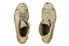 Les vieilles chaussures de sports ont isolé le blanc Photographie stock libre de droits