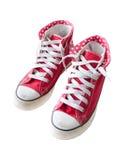 Les vieilles chaussures rouges d'espadrille ont isolé le blanc Photographie stock libre de droits