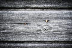 Les vieilles planches en bois avec la peinture d'épluchage aiment le fond toned image libre de droits