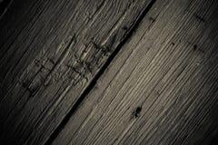 Les vieilles planches en bois avec la peinture d'épluchage aiment le fond toned photographie stock libre de droits