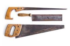 Les vieux outils, scie/scies à main ont isolé - le vintage Image stock