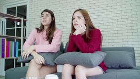 Lesbian Asian couple crying while watching drama in TV in living room at home, sweet couple enjoy romantic moment. Lesbian Asian couple crying while watching stock video