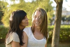 Lesbian couple. Happy lesbian couple outdoors smiling stock photo