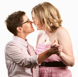 Lesbian Couple Dancing. Two lesbian women dancing together over white background Royalty Free Stock Photography