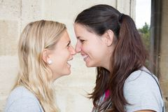 Lesbian Couple girls Kissing on city stock images