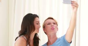 Lesbian couple having fun together taking selfie stock video