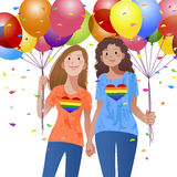 Lesbian couple holding hand each other and balloons Royalty Free Stock Image