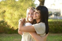 Lesbian couple hugging. Outdoors smiling stock image