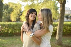 Lesbian couple hugging. Outdoors smiling royalty free stock photo