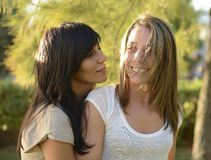 Lesbian couple hugging. Outdoors smiling stock images