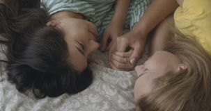 Romantic lesbian couple lying in bed. Lgbt, homosexual, pride, bisexual, gay lovewins equality, loveislove friendship