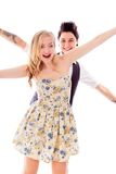 Lesbian couple standing with arm outstretched Stock Photo