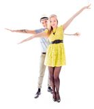 Lesbian couple standing with arm outstretched Royalty Free Stock Images