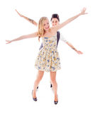 Lesbian couple standing with arm outstretched Stock Photos