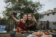 Lesbian couple taking a selfie stock photos