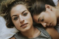 Lesbian couple together in bed royalty free stock images