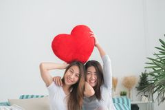 Lesbian couple together concept. Couple of young women holding p stock photos