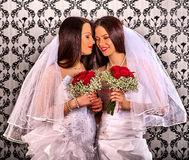Lesbian couples in wedding bridal dress kissing . Stock Photo