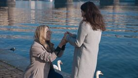Pretty lesbian girl proposing to her girlfriend to get married. Pride, lgbt, love wins, tolerance, gay concept. Filmed