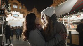 Lesbian girls in love at xmas time. Night prague old town square. Pride, lgbt, love, friendship, christmas, holiday