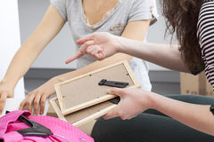 Lesbian packing stuff Royalty Free Stock Images
