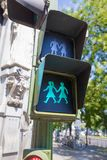 Lesbian symbol traffic light in Madrid city. Green silhouette of couple of two women holding hand in pedestrian traffic light, public symbol lesbian and gay Royalty Free Stock Photo