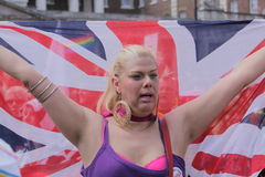 Lesbian woman carrying British flag Stock Image