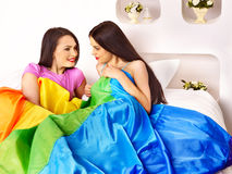 Lesbian women at erotic foreplay game in bed. Stock Photography