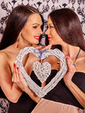 Lesbian women with heart  kissing in erotic Royalty Free Stock Photos