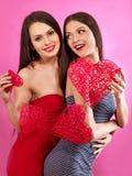 Lesbian women holding heart symbol Stock Image