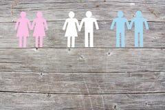 Lesbienne gaie et couples droits sur le fond en bois Photos stock
