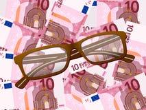 Lesebrille auf Hintergrund des Euros zehn Lizenzfreie Stockfotografie