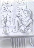 Lesen nahe dem Winterfenster Stockbilder