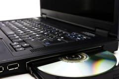 Leser des Laptops DVD Stockfoto