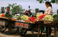 Leshan, China: Women Selling Produce Royalty Free Stock Photography